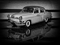 Volga m taxi black and white image with a beautiful gaz die cast model car Royalty Free Stock Photography