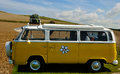 Volkswagen bulli hippy version parked in countryside Stock Photos