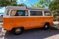Volkswagen camper van orange on a sunny day Stock Photos