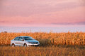 Volkswagen Polo Car Sedan Parking Near Country Road In Autumn Field Royalty Free Stock Photo