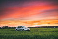 Volkswagen Polo Vento Car Sedan On Country Road In Spring Wheat Royalty Free Stock Photo
