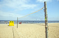 Volleyball net sea waste bin boat people relax Royalty Free Stock Image