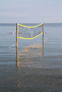Volleyball net on the sea water Stock Image