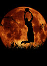 Volleyball woman player jumping. Moon at night