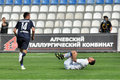 Volovyk knocks down burduzhan during the match between metallurg donetsk city ukraine vs chernomorets odessa city ukraine may Stock Photos