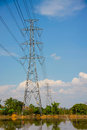 Voltage pole high with blue sky and cloud on bright day Stock Photos