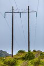 Voltage poles, electricity pylon, transmission power tower Royalty Free Stock Photo
