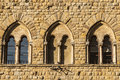 Volterra pisa three mullioned windows tuscany italy of a medieval palace Royalty Free Stock Photography