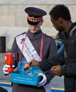 A volunteer selling poppies on Armistice Day Royalty Free Stock Photo
