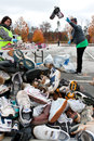 Volunteer tosses sneakers into shoe pile at recycling event lawrenceville ga usa november volunteers sort and toss a large of Royalty Free Stock Photo