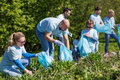 Volunteers With Garbage Bags C...