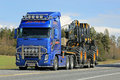 Volvo FH Truck Hauls Ponsse Forest Harvester Royalty Free Stock Photo