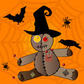 Voodo halloween voodoo doll in witches hat crow and elements Stock Image