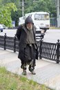 Voronezh, Russia - Circa 2014: Homeless sad old man walking along street Royalty Free Stock Photo
