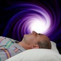 Vortex meditation man with eyes closed lying supine enjoying on a black background Royalty Free Stock Images