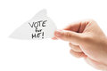 Vote for me elections campaign concept using a hand holding a paper on white background Stock Photography