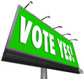 Vote yes green billboard sign approve proposal affirmative words on a big outdoor to encourage you to affirm or accept a candidate Royalty Free Stock Images