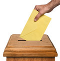 Voting hand putting envelope into the box isolated on white background clipping path Royalty Free Stock Photo