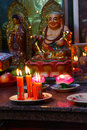 Votive candles and incense, with Buddha Royalty Free Stock Photo