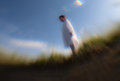 Vow boy concentrated on in white shirt outdoors dawn creative lens any processing in computer graphic editors Royalty Free Stock Images