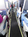 Voyage de personnes sur le passager jet airliner Image stock