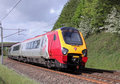 Voyager train on West Coast Main Line in Cumbria. Royalty Free Stock Photos