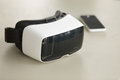 VR headset and smartphone on desk, virtual reality mobile techno