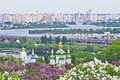 Vydubychi monastery and left bank of dniper view on domes blooming trees high buildings on the in kiev ukraine Royalty Free Stock Photography