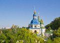 Vydubychi monastery view of buildings in green trees in spring Stock Images