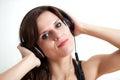 W ear-phones młoda kobieta Fotografia Stock