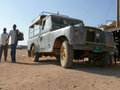 Wadi halfa sudan november two strangers nubians going past the jeep in old jeep architectural building Royalty Free Stock Images