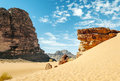 Wadi rum desert in jordan on a sunny day in the background are mountains Royalty Free Stock Photo