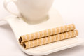 Wafer chocolate cream rolls on the coffee plate Royalty Free Stock Photo