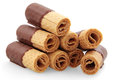 Wafer rolls with chocolate on white background Royalty Free Stock Images