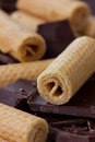Wafer rolls with pieces of chocolate Royalty Free Stock Photo