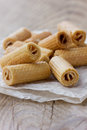 Wafer rolls on rustic table a wooden Royalty Free Stock Images