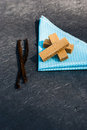 Wafers with vanilla pods on napkin Royalty Free Stock Photography