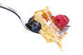 Waffle with berries on a fork (clipping paths) Stock Photo