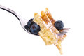 Waffle with berries on a fork (clipping paths) Stock Image
