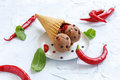 Waffle cone with chocolate ice cream and chili.