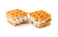 Waffle with cream a broken in half isolate on white Royalty Free Stock Image