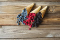 Waffle with fresh berries. Berries. Raspberries, blackberries, blueberries in waffle cones on a gray abstract background. Royalty Free Stock Photo