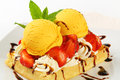 Waffle with ice cream and strawberries belgian topped whipped fresh Royalty Free Stock Photo