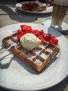 Waffle with strawberries and ice cream Royalty Free Stock Photo