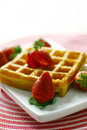Waffle and strawberry Stock Images