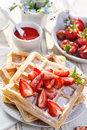 Waffles with addition fresh strawberries on white plate delicious organic table vegetarian breakfast and dessert Royalty Free Stock Images