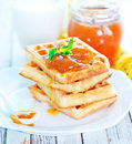 Waffles with apricot jam Royalty Free Stock Photo