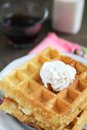 Waffles for breakfast with foamy cream and a glass of milk a delicious Stock Images