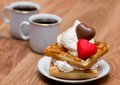 Waffles and coffee sweet with whipped cream chocolate marzipan candies two cups of Royalty Free Stock Images