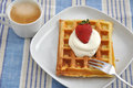 Waffles with cream and strawberries Stock Images